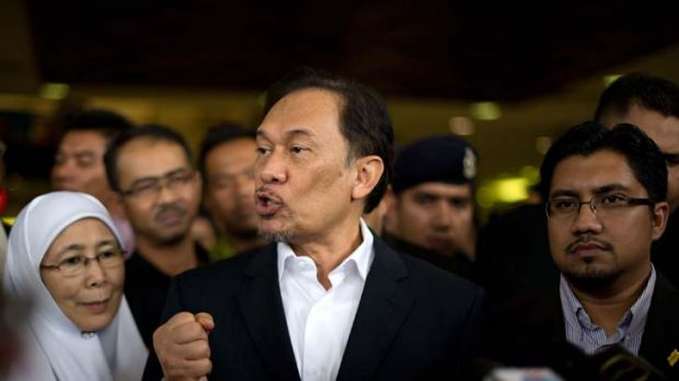 ''Politically motivated'' ... the Malaysian Opposition Leader, Anwar Ibrahim, puts his case outside court yesterday ...