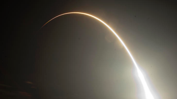 The Falcon 9 SpaceX rocket is seen during a time exsposure as it lifts off from space launch complex 40 at the Cape ...