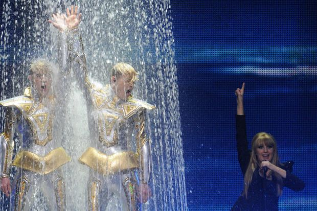 Ireland's pop duo Jedward take a shower as part of their performance.