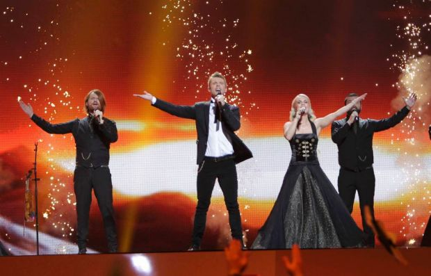 """Iceland's Greta Salome (2nd R) and Jonsi (2nd L) perform their song """"Never Forget""""."""