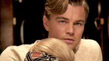 In this film image released by Warner Bros. Pictures, Leonardi DiCaprio, portrays Jay Gatsby and Carey Mulligan portrays ...