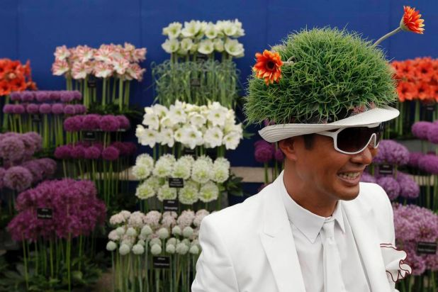 Hong Kong businessman William Louey poses in his floral hat.