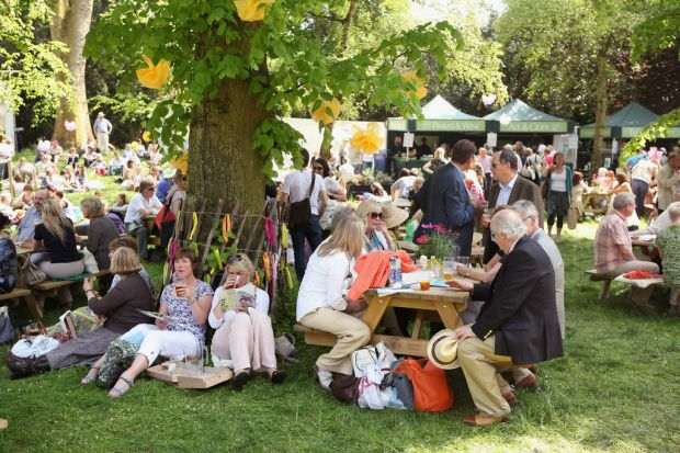 Visitors to the Royal Horticultural Society's Chelsea Flower Show relax in the shade.