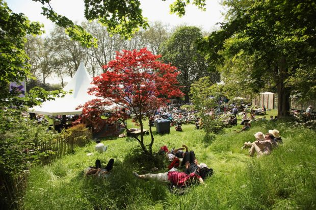 Visitors to the Royal Horticultural Society's Chelsea Flower Show relax in the shade in the high temperatures.