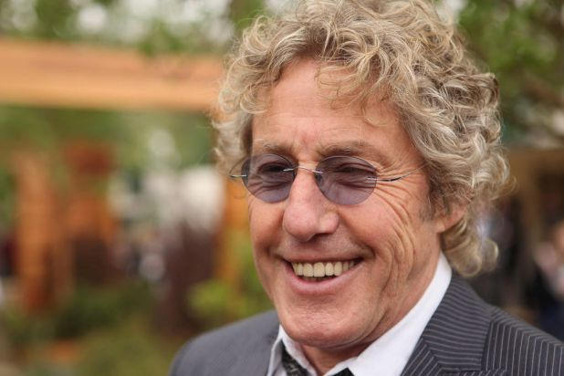 Roger Daltrey, the frontman for The Who, poses for photographers.