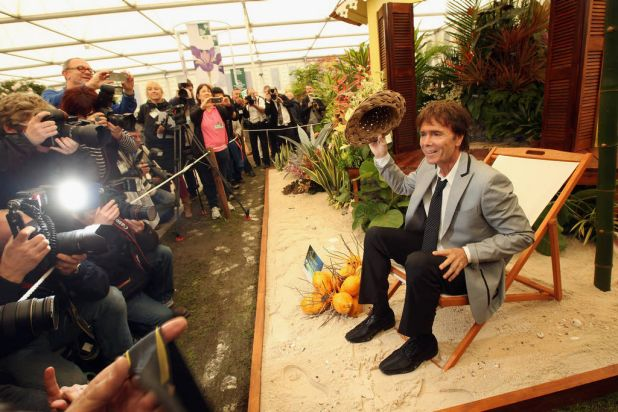 Sir Cliff Richard poses for photographers on the Barbados Horticultural Society's 'Summer Holiday' stand in the Great ...