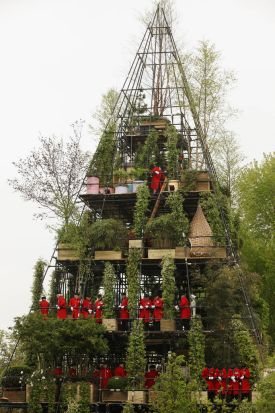 Chelsea pensioners stand on the upper levels of designer Diarmuid Gavin's creation, 'The Westland Magical Garden' .