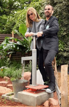 Ringo Starr, a former drummer with the Beatles, and his wife Barbara Bach use a hand pump at the opening of the 'Herbert ...
