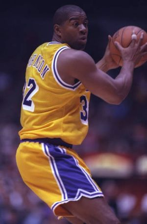 Magic man: Earvin Johnson playing for the LA Lakers in 1996.