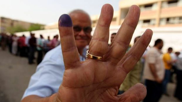 An Egyptian shows he has voted at a polling station in Cairo.