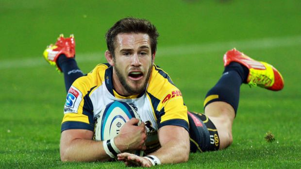 Zack Holmes of the Brumbies scores a try during the round 13 Super Rugby match between the Hurricanes and the Brumbies ...