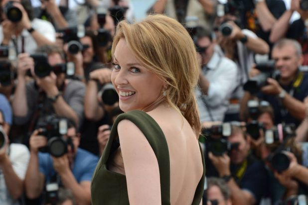 """Australian actress Kylie Minogue poses during the photocall of """"Holy Motors"""" presented in competition."""