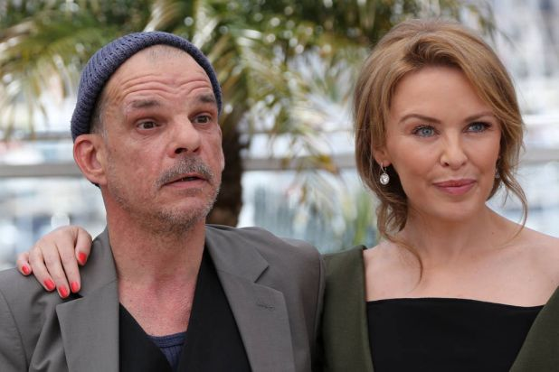 """French actor Denis Lavant and Australian actress Kylie Minogue pose during the photocall of """"Holy Motors""""."""