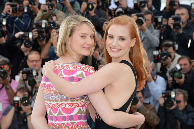 """(From L) Australian actress Mia Wasikowska and US actress Jessica Chastain pose during the photocall of """"Lawless""""."""