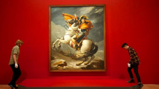 Art handlers Kieran Champion and Somone Tops at the NGV hung the painting <i>Napoleon Bonaparte crossing the Alps</i> ...