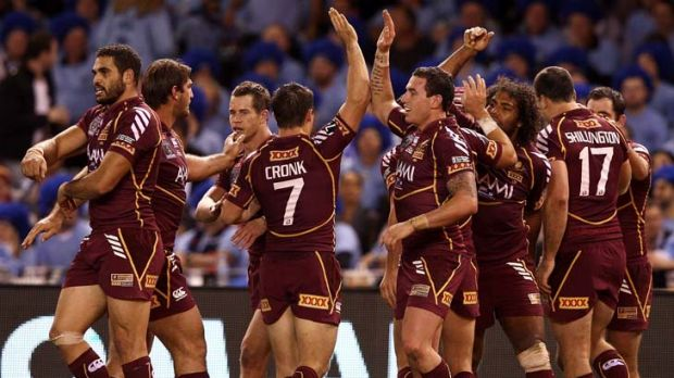 Queenslander ... the Maroons celebrate a try during last night's Origin match.