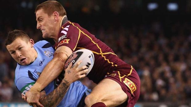 Wrapped up … Origin rookie Todd Carney is taken down by veteran Brent Tate.