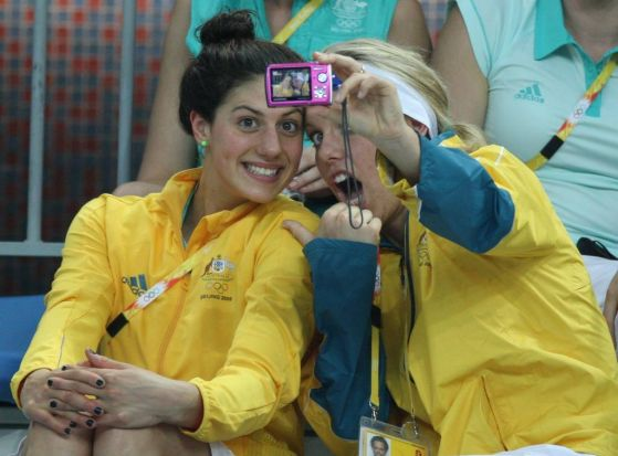 Swim fan ... Stephanie Rice poolside with teammate Meagan Nay.