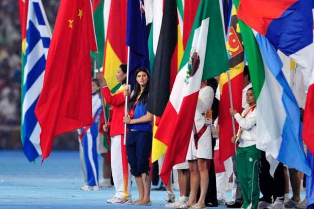 Flag bearer ...  Stephanie Rice carrying the Australian flag at the closing ceremony.