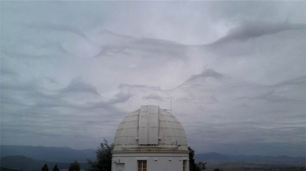 A strange combination of clouds gathering over Mt Stromlo gave the sky an eerie feel yesterday.