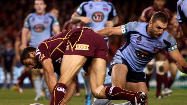 Drop zone … Maroons centre Greg Inglis loses control of the ball after Blues hooker Robbie Farah had rushed across ...