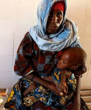 Mariama Awa cradles her son Malla as they sit and wait in a relief centre in Maine Soroa, in the remote south-east ...