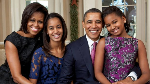 The official Obama family portrait: Michelle with Barack and children Malia and Sasha.