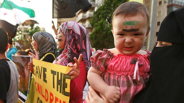 A child with a Syrian opposition flag painted on the face takes part in a protest in Tripoli, northern Lebanon, against ...