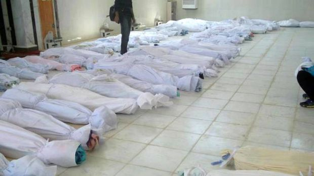A handout picture released by the Syrian opposition's Shaam News Network shows bodies lying at a hospital morgue after ...