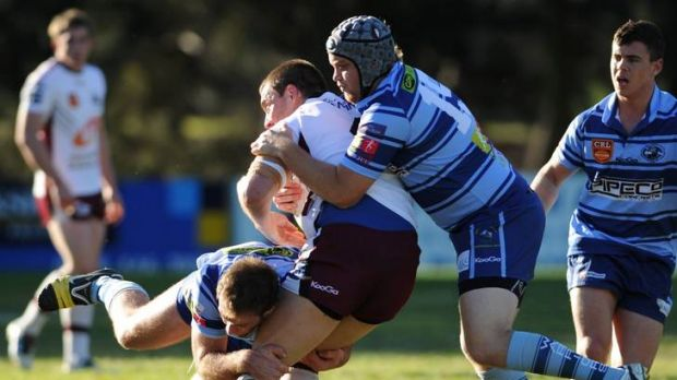 Queanbeyan's Josh Toohey is tackled by Warriors duo Brett Frawley, left, and Tom Peadon.