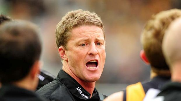 Richmond coach Damien Hardwick urges his team on at quarter-time.