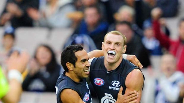 Blues in arms: Mitch Robinson (right) celebrates his goal with Eddie Betts.