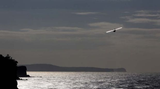 Depth of feeling .... a seaplane conducts a fly-past yesterday to symbolise an air search the day after a deadly attack ...