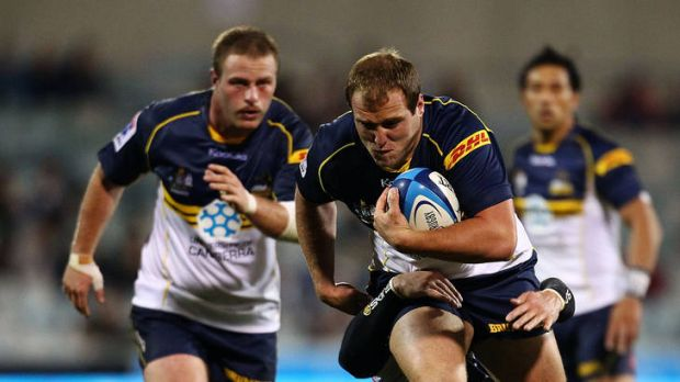 Ben Alexander of the Brumbies runs the ball during the round eight Super Rugby match between the Brumbies and the Rebels ...