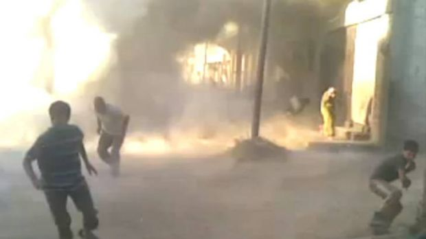 This still from an amateur video by Syrian activists shows people running for their lives during weekend attacks in ...