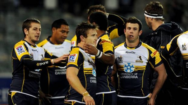 A shattered Zack Holmes is comforted by Brumbies teammates after his penalty miss against the Reds.