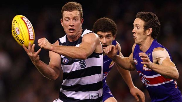 Steve Johnson of the Cats handballs during the round nine AFL match between the Western Bulldogs and the Geelong Cats at ...