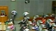 Opposition Leader Tony Abbott makes a failed dash for the door of Parliament.