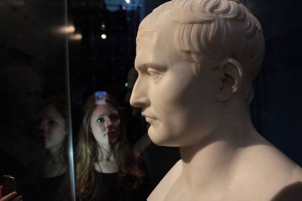 Jessica Hedger looks at a bust of Napoleon.