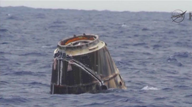 Space Exploration Technologies' unmanned Dragon capsule floats in the Pacific Ocean off of Baja California in this May ...