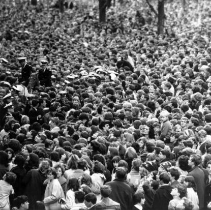 The crowd await the arrival of The Beatles in Melbourne, Australia, June 1964.
