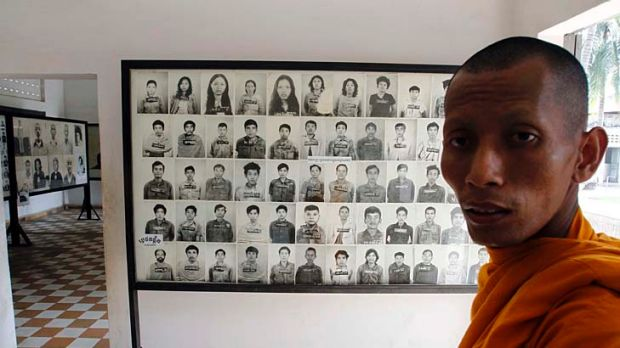 Faces of genocide: A Buddhist monk in the museum at the former Tuol Sleng prison where the Khmer Rouge held thousands of ...