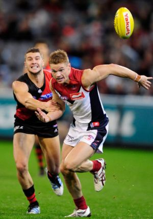 Off the mark: Melbourne's Colin Sylvia (right) breaks away from Essendon's Tayte Pears.