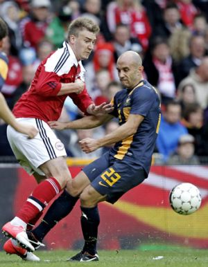 Denmark's Nicklas Bendtner, left, tussles with Mark Bresciano.