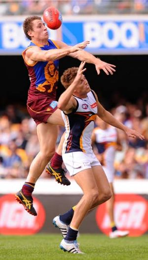 James Polkinghorne of the Lions soars above Eagle Brad Sheppard in a sign of things to come.