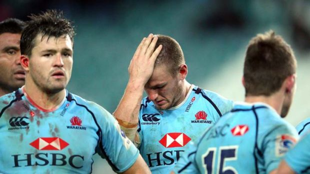 Feeling blue ... dejected Waratahs contemplated Saturday's defeat, their sixth in a row, to the Hurricanes at Allianz ...