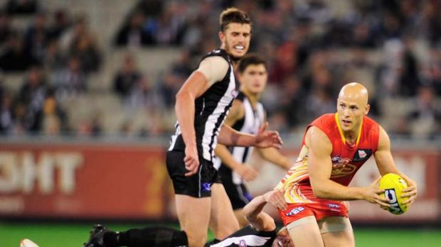 Hard to hold: Gary Ablett breaks away from Dale Thomas at the MCG yesterday.