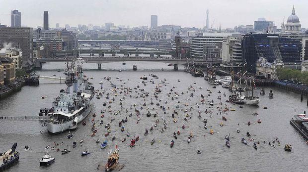 The flotilla makes its way to Tower Bridge.