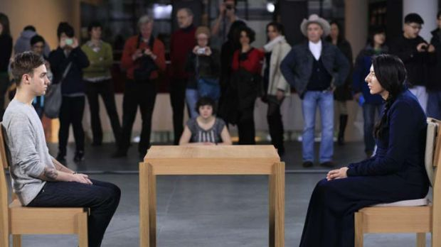 Still life … Marina Abramovic and a visitor during a performance piece, <EM>The Artist is Present</EM>, at the ...