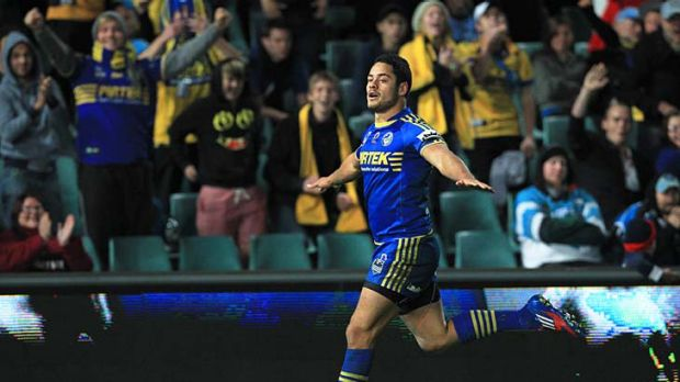Taking flight ... Jarryd Hayne celebrates after scoring one of his two tries.